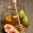 Ripe Fig Fruits with honey — Stock Photo #20088811