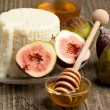 White cheese with figs and honey - Photo