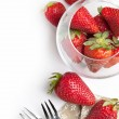Fresh strawberries over white — Stock Photo