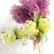 Bunch of lilac flowers on white wooden table - Stock Photo