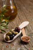 Olives with olive oil and spices — Stock Photo