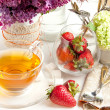 Breakfast with tea and strawberries - Stock Photo