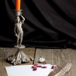 Still-life with old candlestick and pepper - Stock Photo