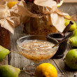 Pear jam in glass vase and fresh pears on old wooden table — Stock Photo #20093471