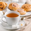Breakfast with cinnamon buns - Stock Photo
