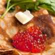 Red caviar on pancakes - Stock Photo
