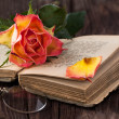 Orange rose with old book and glasses — Stock Photo #20097153