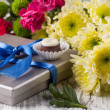 Chocolate candy and flowers - Stock Photo