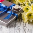 Chocolate candy and flowers — Stock Photo #20097363