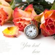 Orange roses with vintage clock — Stock Photo #20097759