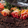 Roses, chocolate and coffee beans — Stock Photo