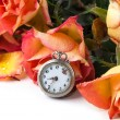 Orange roses with vintage clock — Stock Photo