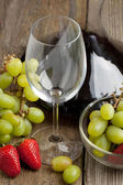 Glass for wine and fruits — Stock Photo