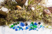 Glass beads with moss — Stock Photo