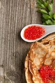 Red caviar and pancakes — Stock Photo