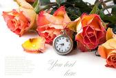 Orange roses with vintage clock — Stock Photo