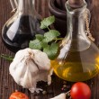 Oil and vinegar, gralic, tomatoes with herb - Photo