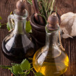 Olive oil and vinegar with herbs - Stock Photo