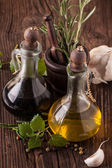 Olive oil and vinegar with herbs — Stock Photo