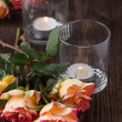 Royalty-Free Stock Photo: Orange roses with lightning candle
