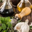 Stock Photo: Oil and vinegar, gralic, knife and herbs