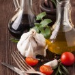 Oil and vinegar, gralic and tomatoes with herbs - Stockfoto