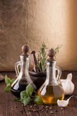 Olive oil and vinegar with herbs — Foto Stock