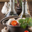Stock Photo: Olive oil and vinegar with mushrooms in pan