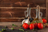 Herb, oil, garlic and tomatoes — Stock Photo
