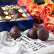 Orange roses with chocolate - Stock Photo