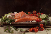 Salmon fish with vegetables and spice — Stock Photo