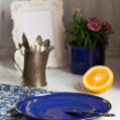 Blue plate, orange and vintage kettle — Stock Photo