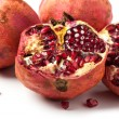 Pomegranates over white — Stock fotografie