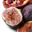 Close-up of figs and pomegranate — Stock Photo