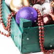 Green box of christmas toys — Stock Photo
