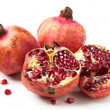 Foto Stock: Pomegranates over white