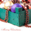 Christmas card with box of toys — Stock Photo