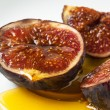 Figs and honey — Stock Photo #31933395