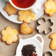Sugar cookies with black tea — Stock Photo