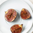 Figs on white plate — Stock Photo