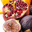 Close up of figs and pomegranate — Stock Photo