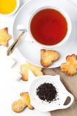 Biscotti di zucchero con tè nero — Foto Stock