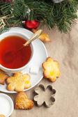 Sugar cookies with black tea — Stock Photo