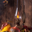 Old lamp with pumpkins, acorns and leaves — Stock Photo