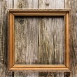 Vintage frame on old wooden background — Stock Photo