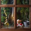 Christmas decoration with teddy bear in window — Photo #34063877