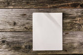 Wood and paper background — Stock Photo