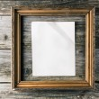 Vintage frame with paper on old wooden background — Stock Photo