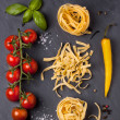 Dry pasta with tomatoes, basil and pepper — Stock Photo