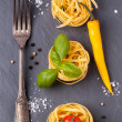 Dry pasta with tomato, basil and pepper — Stock Photo #34598639